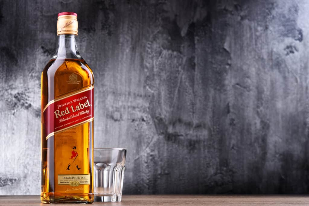 Bottle of Johnnie Walker, the most widely distributed brand of blended Scotch whisky in the world with sales of over 130 million bottles a year.