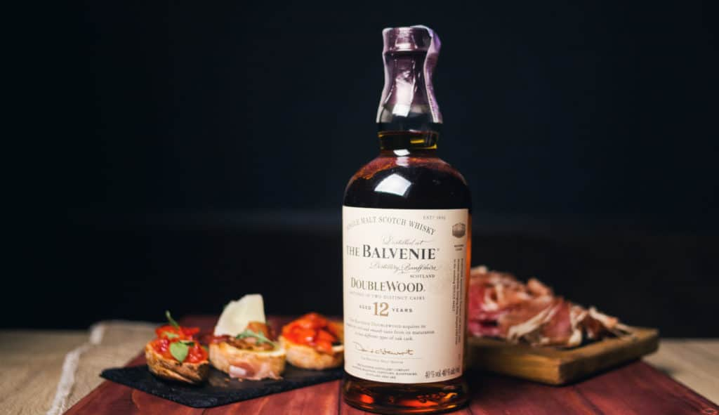 The Balvenie Scottish single malt whisky bottle with snack in restaurant.