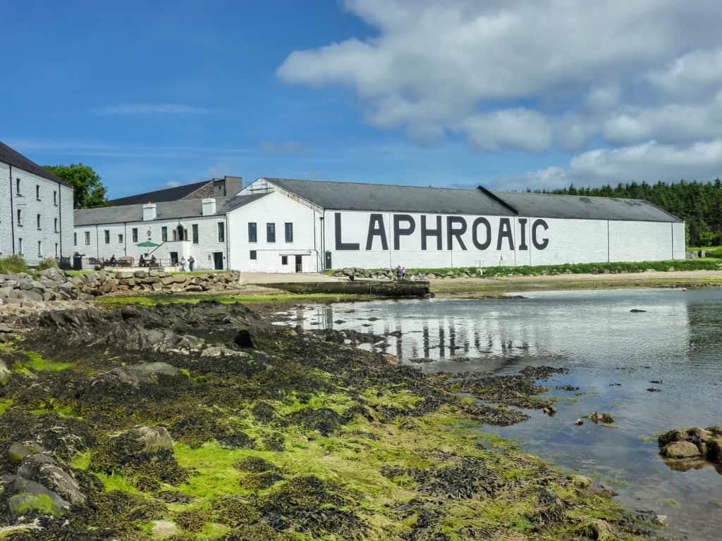 The sun shines on Laphroaig distillery warehouse